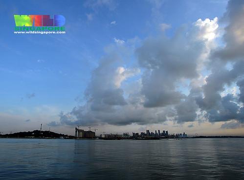 Singapore city looks tiny under a vast sky