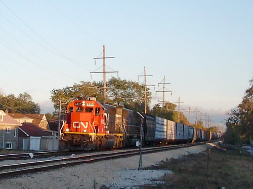 Westbound Canadian National freight train approaching the Riverside Drive railroad crossing. Berwyn Illinois. October 2007. by Eddie from Chicago
