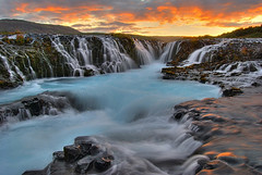 Brarfoss II (_olasso) Tags: world travel blue sunset summer orange white hot cold nature water yellow clouds contrast river landscape waterfall iceland bravo rocks stream natural earth august falls environment glowing 2008 hdr afterglow photomatix 4exp brarfoss brar rnesssla