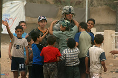 www.Army.mil (The U.S. Army) Tags: children soldier army iraq baghdad soldiers hugs combatcamera
