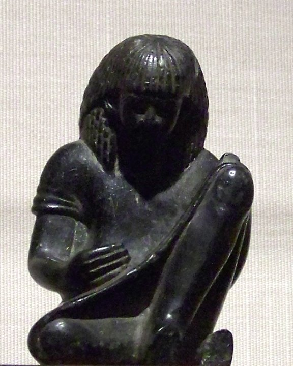 A statue of an Egyptian scribe