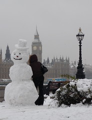 topper (estherase) Tags: uk snow london smile hat thames bench snowman findleastinteresting strangers housesofparliament bigben stranger lampost tophat commute peopleidontknow palaceofwestminster emssimp at