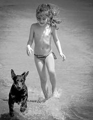 Follow You Follow Me (lothar1908) Tags: camera bw beach cane canon mare child estate corsica bn cecilia movimento arenas 70200 spiaggia biancoenero backwhite isola prospettiva esterno bambina fotocamera bagnasciuga dinamica canoneos50d
