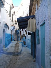 Chaouen street (genevievelepine) Tags: street city travel blue shirt alley morocco maroc hanging chaouen chefchaouen genevievelepine