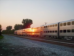 Westbound Metra passing through Elmwood Park Illinois at sunset. September 2007.