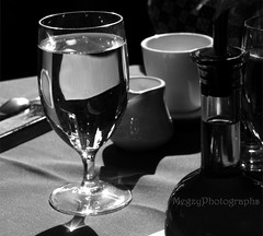 WMEtsyFresco02 (MegzyTred) Tags: blackandwhite stilllife water monochrome reflections etsy oliveoil tablescape whitemug waterglass frescorestaurant megzytred megzyphotographs tredlightphotographs