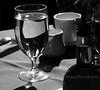 WMEtsyFresco02 (MegzyTred) Tags: blackandwhite stilllife water monochrome reflections etsy oliveoil tablescape whitemug waterglass frescorestaurant megzytred megzyphotographs tredlightphotographs