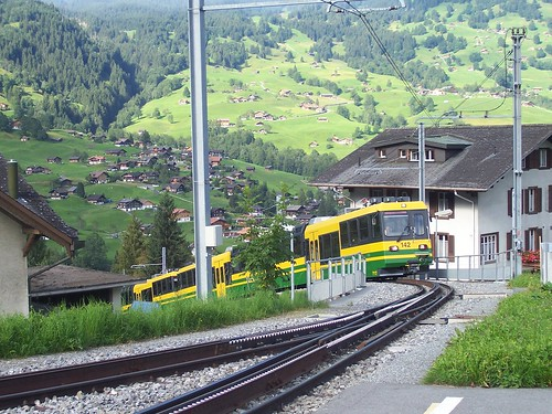 A Wengeneralp Bahn train climbs up to Grindelwald station