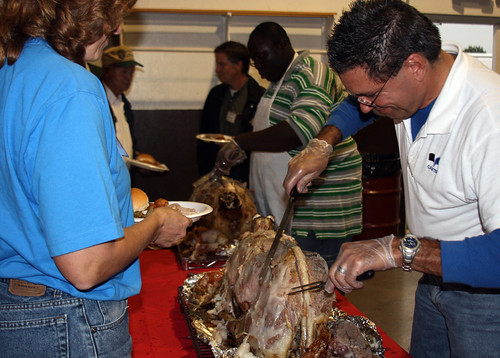 Todd Morren from the Hagerstown Canteen carves a lamb for dinner