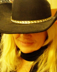 Another Hat   / self portrait (**Ms Judi**) Tags: woman selfportrait me smile face hat smiling mystery lady female self myself nose gold golden alone chain cheeks blonde ms mysterious blondie soe cowgirlhat msjudi leaveyourhaton goldstaraward