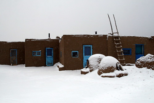 Part of the Pueblo, with ladders and ovens