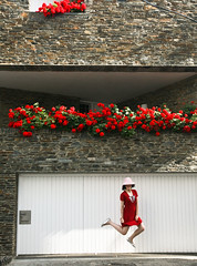 jumping lady in red (sgoralnick) Tags: alexis trip travel flowers red vacation jump jumping spain catalonia costabrava reddress cadaques flybutter