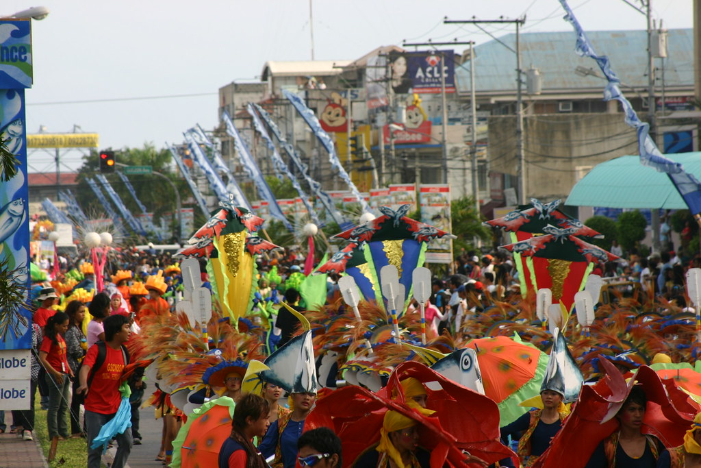 Pioneer Avenue blooms with MardiGras dancers and spectators.
