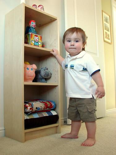 his shelf.