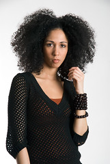Beautiful African-American woman with afro in fishnet top (jackie weisberg) Tags: girls people woman girl beautiful vertical female hair beads women image african afro curls fishnet bighair exotic curly photograph american africanamerican females ethnic baubles ethnicity bangles greathair modelrelease colorimage flickeraward afroes fishnettop jackieweisberg