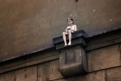 The Girl on the Wall (Gilderic Photography) Tags: street city winter sculpture art girl strange statue wall modern lumix funny europe prague hiver fake praha panasonic odd illusion fille ville insolite klementinum hyperrealist mywinners abigfave gilderic platinumphoto aplusphoto diamondclassphotographer flickrdiamond goldstaraward hyperralisme