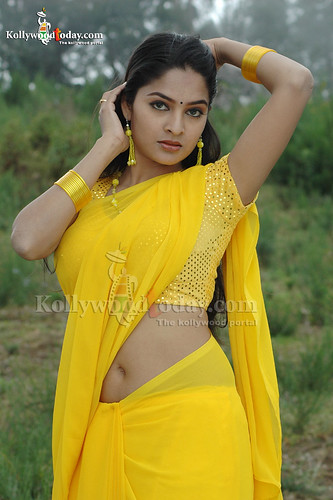 Tamil actress Madhumitha in yellow sari