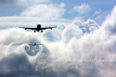 Wake turbulence - Airplanes chasing the clouds (Greg Bajor) Tags: uk vortex london weather clouds plane airplane flying airport heathrow aircraft aviation united flight kingdom aeroplane landing airbus mostinteresting mostfavorited boeing approach 747 a340 chasing descending tailwind whirls waketurbulence wingtipvortices gregbajor