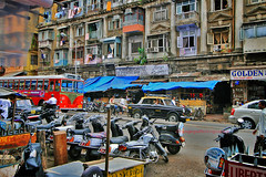 The Colorful Streets Of India (Orangeya) Tags: road street old blue windows red people india signs black streets building bus cars window buses car bike sign yellow shop vintage liberty dad traffic lulu tea taxi indian streetphotography bikes shops motorcycle stores lolo crowded mombai orangeya 0rangeya