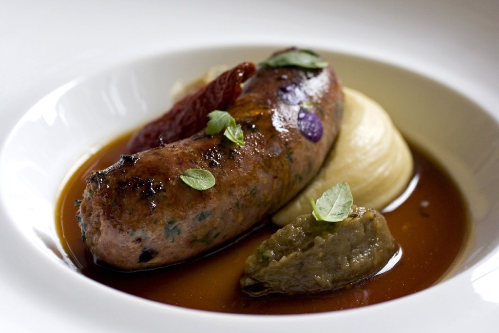 Colorado Lamb Sausage with Eggplant, Tomato Confit and Roasted Garlic