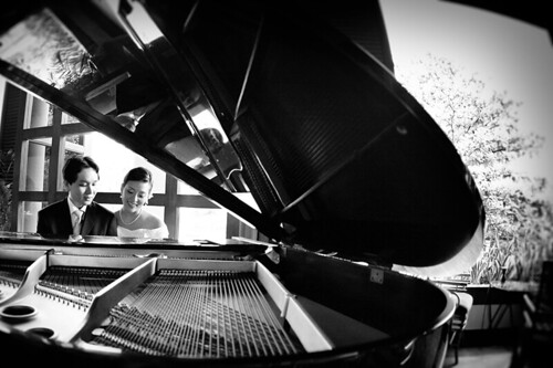 Marcus playing piano for Alicia