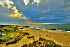 The Sun Peaks Through the Clouds Over the Atlantic in Edisto Beach (marantzer) Tags: sea sun beach digital nikon southcarolina atlantic d200 dslr atlanticocean hdr highdynamicrange shrimpboat edisto dx edistoisland edistobeach afsdxvrzoomnikkor18200mmf3556gifed marantzer