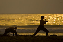 Two Surfers do Pre-stretches on Morro Strand S...