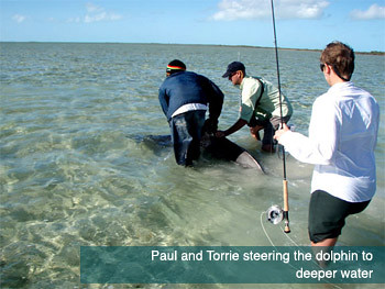 Paul and Torrie steering the dolphin to deeper water