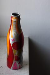 Cola now. (antoagresta) Tags: canon 50mm bottle colours cola drink contemporary conceptual coca aluminium 450d