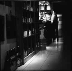the quinella (hurtingbombz) Tags: blackandwhite bw food bar hongkong japanese couple tl delta 3b sake 400 yakitori ilford f28 darklife pentaconsix 150mm pushedtwostops kaleinar pushedtoiso1600