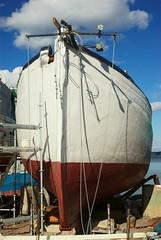 Fat Bottom (JanneM) Tags: blue red sky cloud white color nature finland dock harbour transport fluffy helsingfors fishingboat