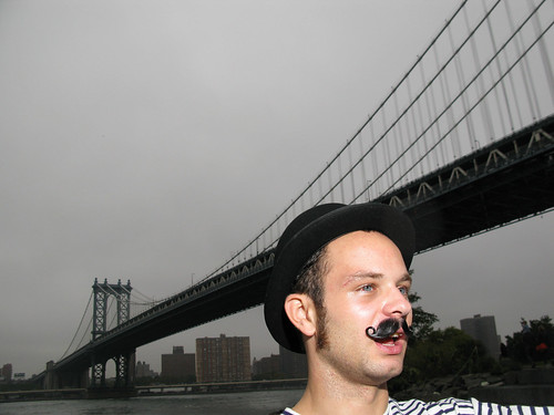 Landon Jones after a full day of convincing folks to drink the Entire Static Volume of the East River. by Justin Parr