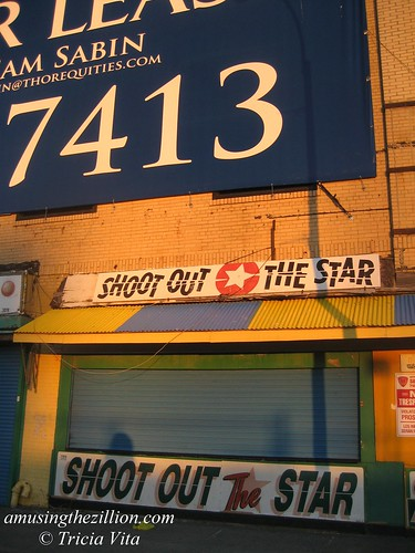 Lettering on Thor Equities banner Dwarfs Shoot out the Star.  Photo © Tricia Vita/me-myself-i via flickr