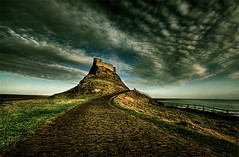 lindisfarne (MartinTheHat (Martin Lowery)) Tags: uk england sky castle clouds fence coast searchthebest path horizon perspective dramatic northumberland processing canon350d coastline drama cobbles nationaltrust northeast canondslr hdr holyisland lindisfarne swoosh englishheritage canondigitalrebelxt gndfilter sigma1020