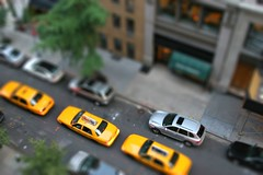 NYC Taxi Cab Tilt Shift (dougschneiderphoto) Tags: street nyc newyorkcity car yellow view manhattan cab taxi aerial sidewalk