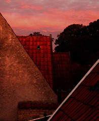 Bricks and tiles with a topping of rose skies (OrangUtanSam) Tags: sky brick sunrise tile denmark dragr roofs walls dragoer lovelyclouds orangutansam johansamsom