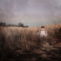the wheat factory (brookeshaden) Tags: travel sky selfportrait fence dark person movement alone texas open gloomy wheat wide human windswept soul sheet lonely tones stillness airy distant nonhuman nikond80