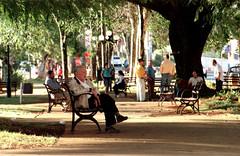 Sinhôzim da praça (Shigow) Tags: brazil brasil square nikon mine time victor mg praça mister passing resting nikkor fm tempo f4 descanso 70210 senhor passando lavras shigueru shigow