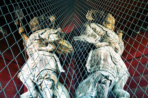 wooden statues in the gate
