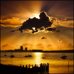 Bursting behind the clouds (adrians_art) Tags: city sunset sky urban cloud reflections boats golden evening silhouettes rays yachts riverthames
