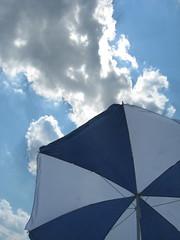 Stolen Beach Umbrella with Clouds (KasiaKowalczyk) Tags: ny brooklyn clouds coneyisland bluesky beachumbrella kasiakowalczyk 1guy3cutegirls