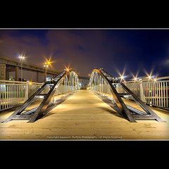 Erie Canal; Gateway to the West (flyingdutchee) Tags: longexposure bridge sky newyork metal night lights star vanishingpoint buffalo glow glare shine steel pedestrian symmetry 1022mm hdr skyway eriecanal bowstring tonemapped flickrsbest flyingdutchee platinumphoto anawesomeshot photoshopcs3 diamondclassphotographer canoneos40d ljomi commercialslip thegreatshooter hdraward magicdonkeysbest