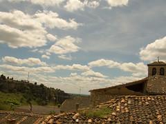 desde los tejados las nubes pasan despacio (kukumismelo) Tags: pueblo nubes campo campanario