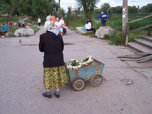 A Babucsya Selling Flower Wreaths for Ivana Kupala