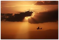 One day I'll fly away... (Silvia de Luque) Tags: light sunset espaa luz plane atardecer andaluca spain bravo granada avioneta ogm alhambra2006 fivestarsgallery silviadeluque randycrawford onedayillflyaway infinestyle bratanesque megashots sierradeparapanda