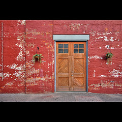 The Red Wall (flyingdutchee) Tags: door red ny building wall composition wooden bricks shapes entrance architectural rochester geometrical minimalism 1022mm hdr tonemapped flyingdutchee photoshopcs3 canoneos40d