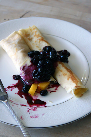 Crepes w/ Peaches and Blueberry Sauce