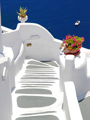 Stairway in Oia, Santorini (MarcelGermain) Tags: travel flowers blue sea summer vacation plants white water stairs geotagged island greek boat nikon holidays steps down stairway santorini greece agave oia escales d80  marcelgermain