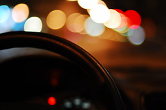 Driving the Bokeh (Inside_man) Tags: colors leather streetlight colorful display bokeh citylife signage dashboard trafficsignal steeringwheel taillight carinterior circlesofconfusion hbw sooc bokehlicious drivingthebokeh