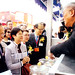 Mr. & Mrs. Tsang Watching Mr. Edward Chan's Product Demo at HKBPE 2008